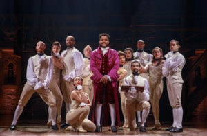 Bryson Bruce, center, with cast of Hamilton. Photo by Joan Marcus.