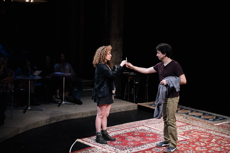 Alexander Strain and an audience member in 'Every Brilliant Thing' at Studio Theatre. Photo by Teddy Wolff.