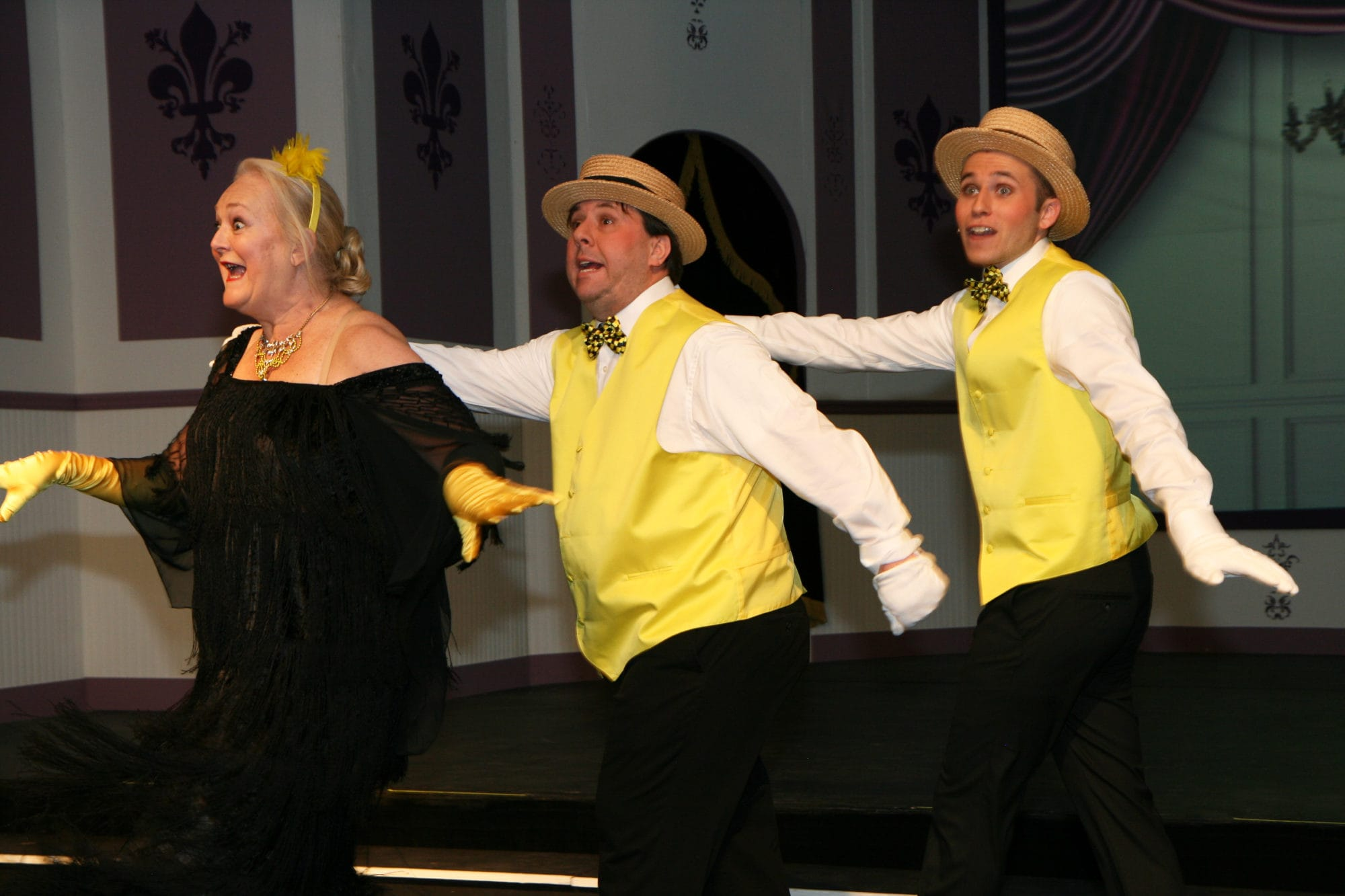 """Missi Tessier, Matt Craun, and Joe Lilek perform """"Be My Little Baby Bumblebee"""" in The British Players' Old Time Music Hall. Photo by Simmons Design."""