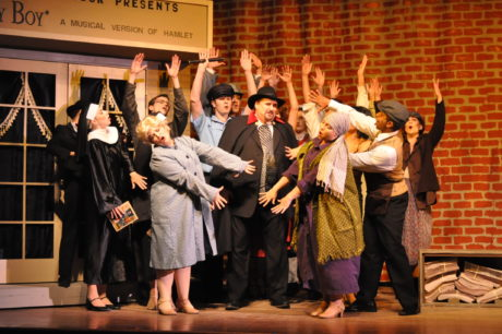 Steve Cairns (center) as Max Bialystock, with the Ensemble in The Little Theatre of Alexandria's production of 'The Producers.' Photo by Matthew Randall.