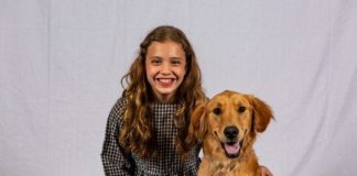 Michelle Stein as Annie and Tucker MacFarlane as Sandy the dog in Prince William Little Theatre's production of 'Annie.' Photo by David Harback.