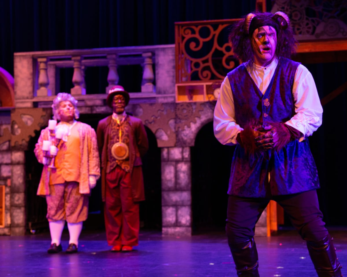 Sterling C. Beard as the Beast in The Arlington Players' production of 'Beauty and the Beast,' with Alden Michels (Lumiere) and Walter Riddle (Cogsworth) looking on. Photo by Rich Farella.