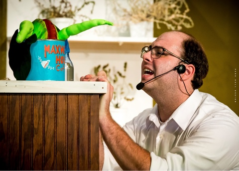 """Seymour (Maverick McKee) begs Audrey II to """"Grow For Me"""" in the Potomac Playmakers' production of 'Little Shop of Horrors.' Photo by Perk Hull Design."""