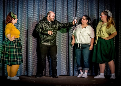 """Orin (Colt Smith) sings about being a """"Dentist!"""" with Ronnette (Andrea Miles), Crystal (Amaya Dull), and Chiffon (Brett Palmer) in Potomac Playmakers' production of 'Little Shop of Horrors.' Photo by Perk Hull Design."""