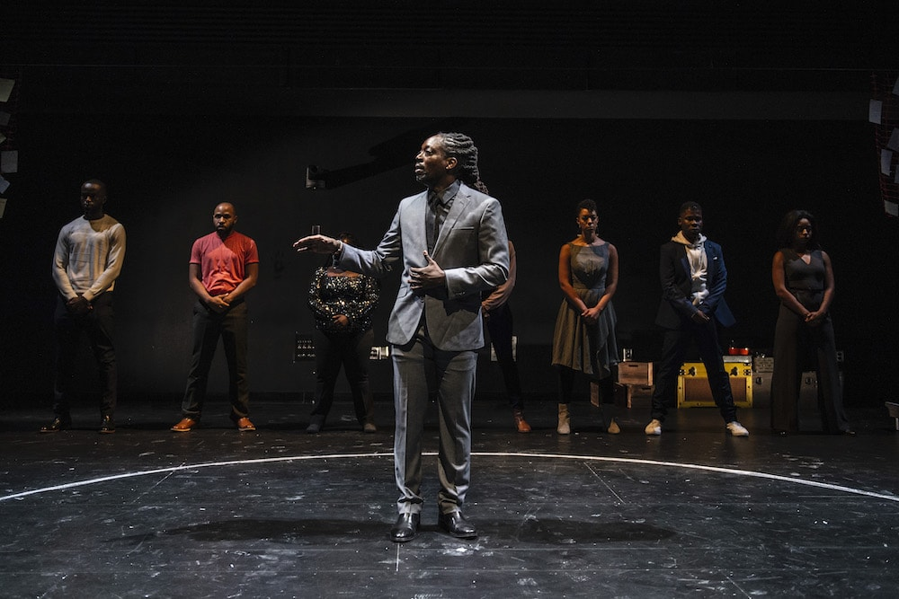 Around the circle: The cast of 'What to Send Up When It Goes Down' (Beau Thom, Ugo Chukwu, Denise Manning, Rachel Christopher, Nemuna Ceesay, Javon Q. Minter, Alana Raquel Bowers), In the center: Kambi Gathesha as the ritual leader. Photo by Teresa Castracane.