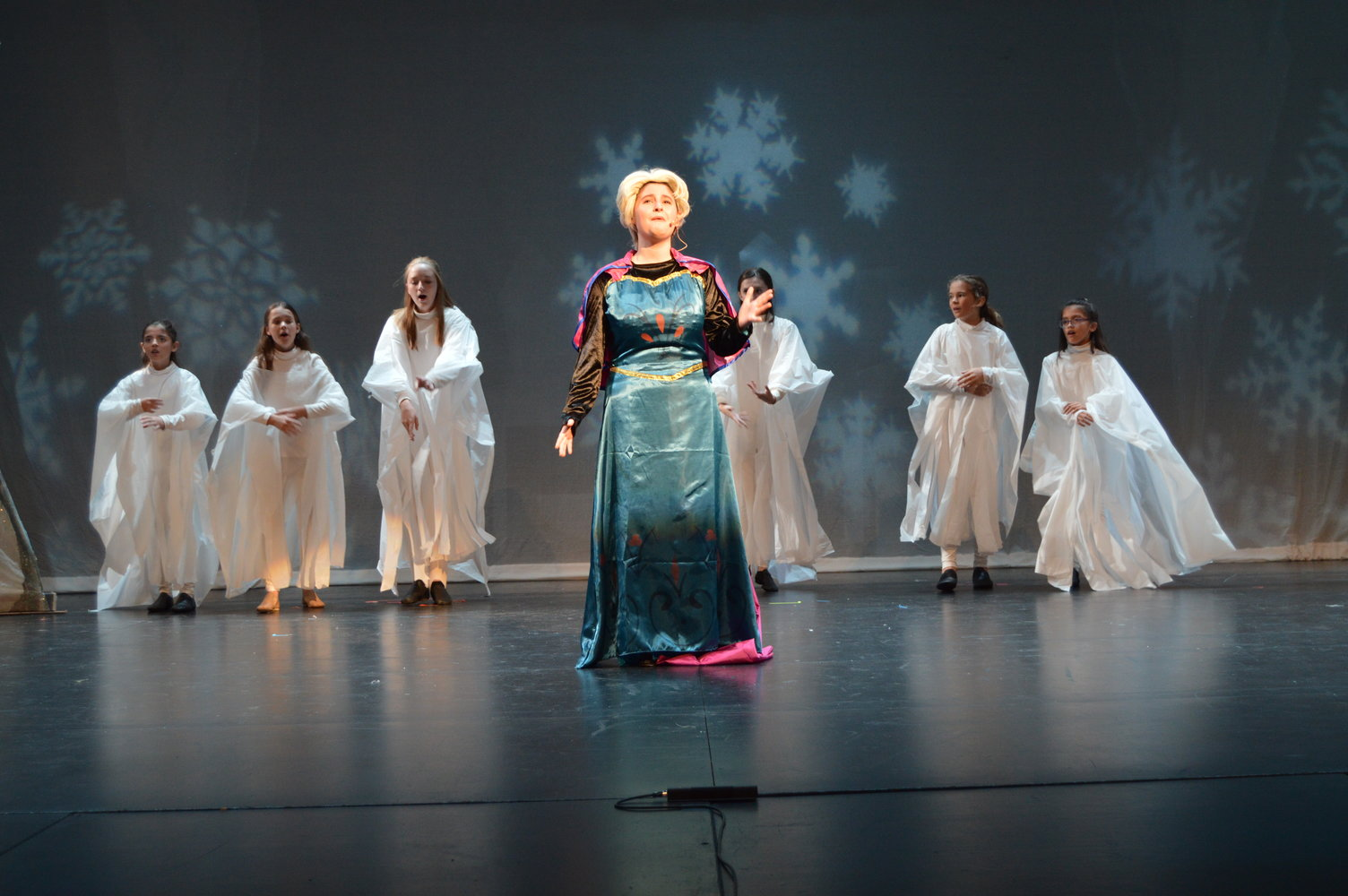 "Elsa (Lucy Rocchio) performs ""Let it go"" in Encore's production of Disney's 'Frozen Jr.' Photo by Aileen Christian."