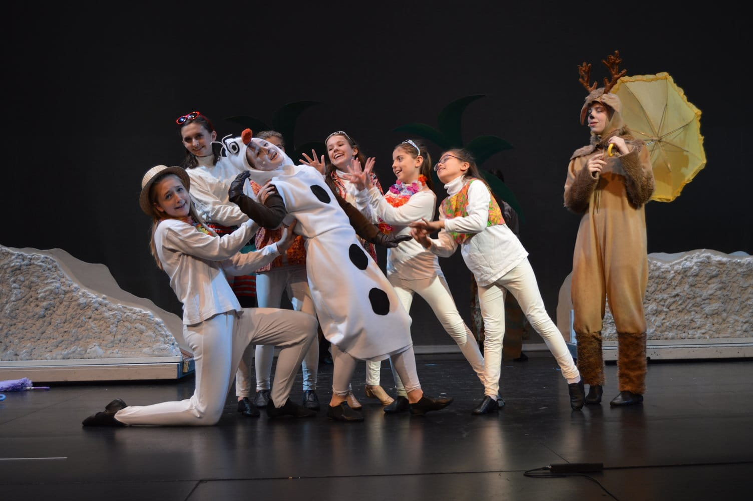 """Olaf (Jillian Michelson), Sven (Sydney Payne) and ensemble perform """"In Summer"""" in Encore's production of Disney's 'Frozen Jr.' Photo by Aileen Christian."""