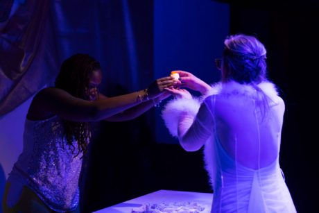 Jasmine Brooks and Amy Rhodes light candles on stage in 'The Powers That Be' at Venus Theatre. Photo courtesy of Deborah Randall/Venus Theatre.