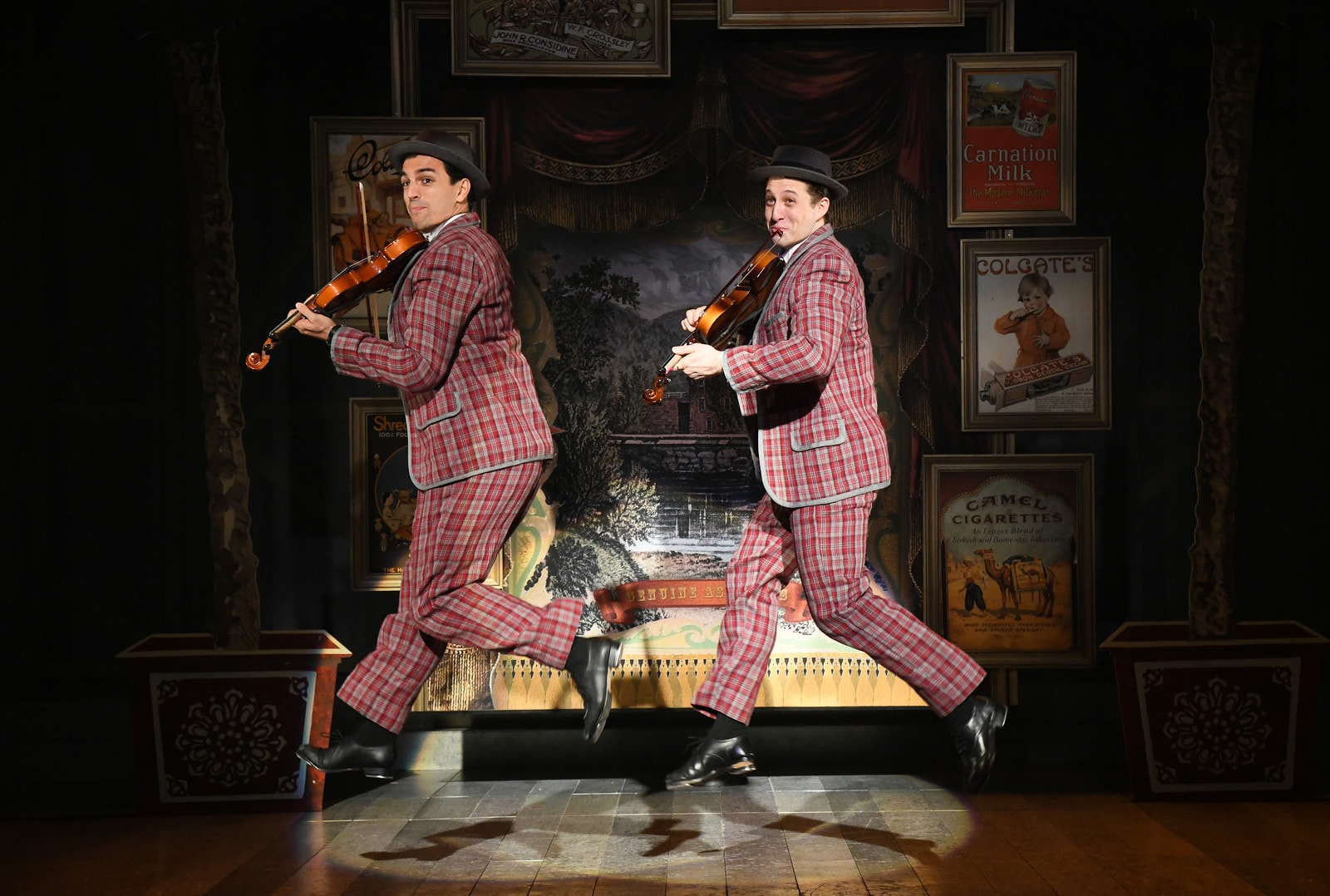 Jacob Scott Tischler as Cosmo Brown and Rhett Guter as Don Lockwood performing 'Fit As A Fiddle' in 'Singin' in the Rain' at Olney Theatre Center. Photo by Stan Barouh Photography.