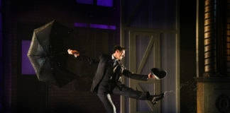 Rhett Guter as Don Lockwood in 'Singin' in the Rain' at Olney Theatre Center. Photo by Stan Barouh Photography.