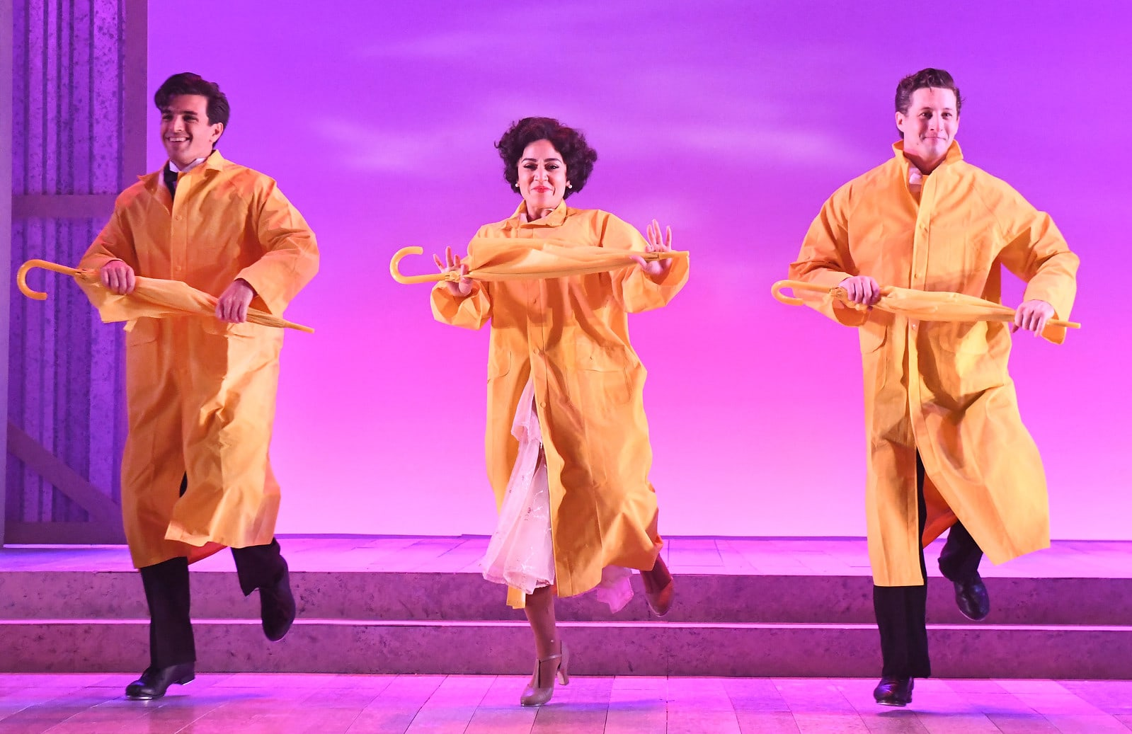 Jacob Scott Tischler as Cosmo Brown, Amanda Castro as Kathy Selden, and Rhett Guter as Don Lockwood in 'Singin' in the Rain' at Olney Theatre Center. Photo by Stan Barouh Photography.