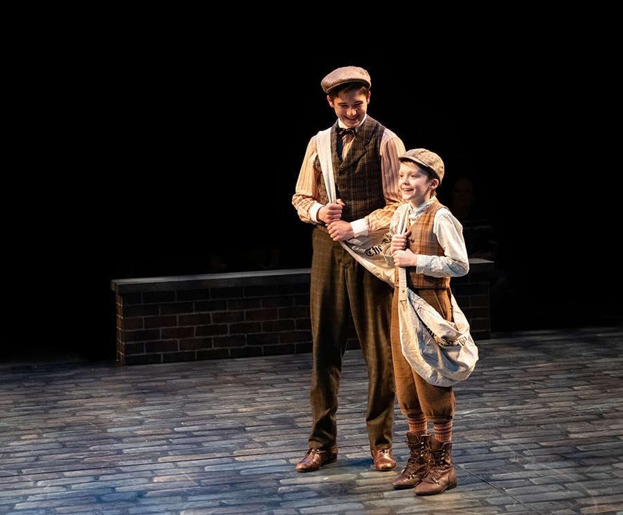 Ethan Van Slyke (Davey) and Josiah Smothers (Les) in 'Newsies' at Arena Stage. Photo by Margot Schulman.