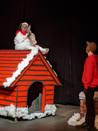 Katherine Blondin as Snoopy and Nick MacFarlane as Charlie Brown in Prince William Little Theatre's production of 'A Charlie Brown Christmas.' Photo by Melissa Jo York-Tilley.