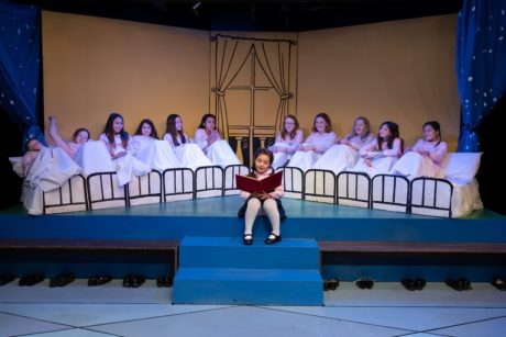 Lara Rosata (center) as Madeline reads to the 12 Little Girls ensemble in Creative Cauldron's 'Madeline's Christmas.' Photo by William T. Gallagher.