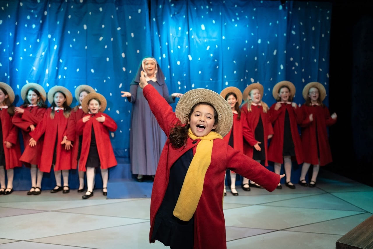 Lara Rosata as Madeline and Anna Phillips-Brown as Miss Clavel with the 12 Little Girls Ensemble in Creative Cauldron's 'Madeline's Christmas.' Photo by William T. Gallagher.