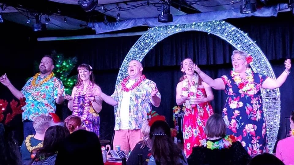 "L-R: Joey Olson, Jolene Vettese, Doug Marcks, Katie Pond, and Kat Brais singing ""Mele Kalikimaka"" in StageCoach Theatre Company's 'Santa's Funky Hawaiian Christmas Cabaret.' Photo by Laura Mills."