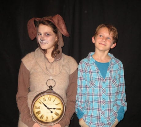 The watchdog Tock (Findley Holland) accompanies Milo (Harper Chadwick) on a quest to rescue the princesses in 'The Phantom Tollbooth' at Greenbelt Arts Center. Photo by Anne Gardner.